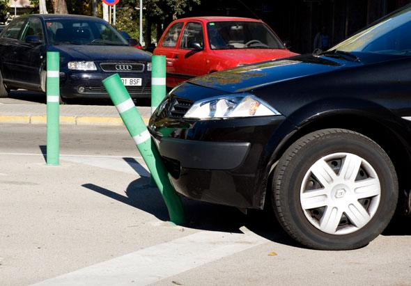 flexible bollard being bent by car
