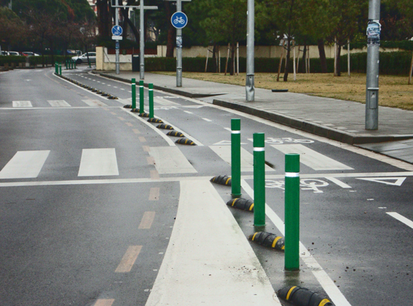 green flexible bollards on bike lane