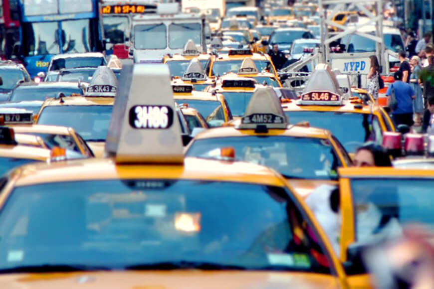 High traffic area shows a traffic jam filled with taxis and buses