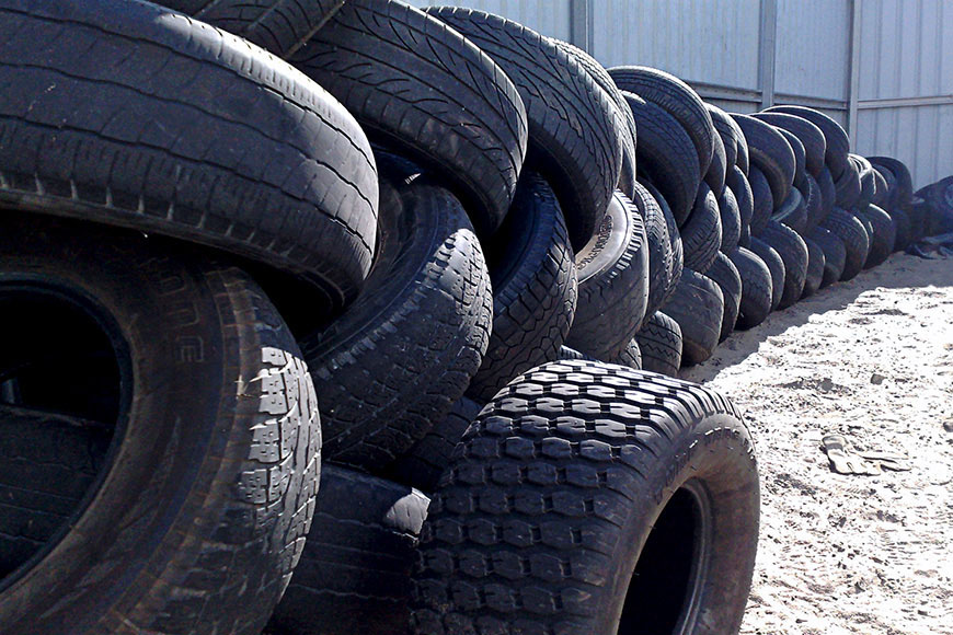 Pile of rubber tires at rubber recycling plant