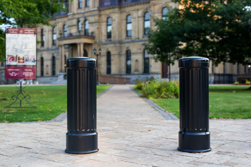 Two bollards at front of path leading to building
