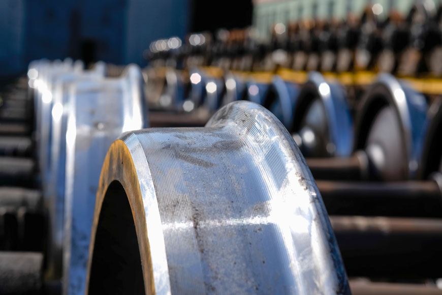 Flanged steel rail wheels shown in storage