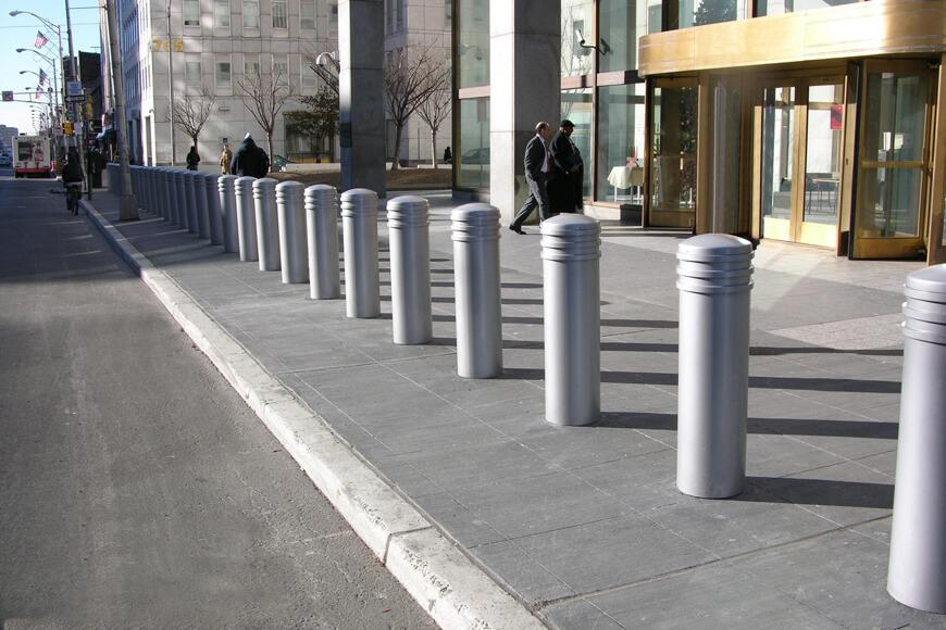 Silver bollards on city sidewalk