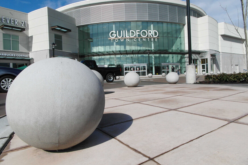 spherical concrete bollards at a mall entrance