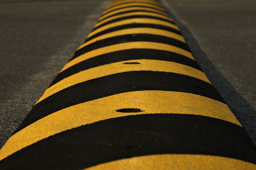 Speed bump on road