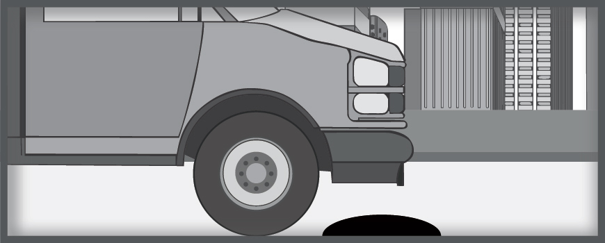 A graphic shows a vehicle approaching a speed bump