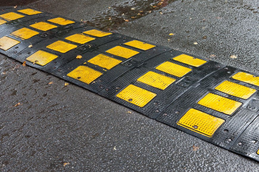 A rubber speed cushion on the road