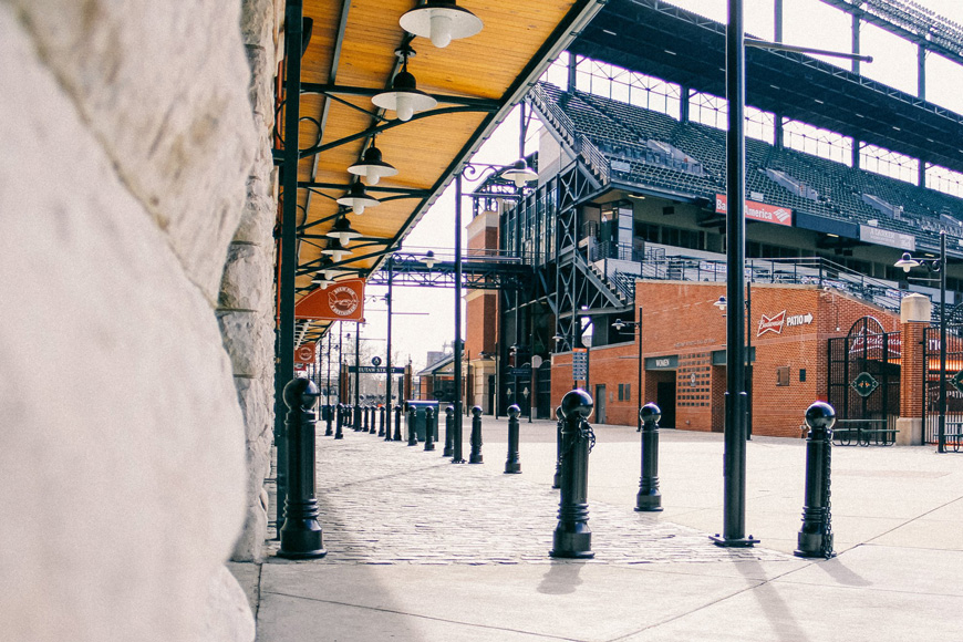 Cast and wrought iron site furnishings enhance red-brick and steel Oriole Park architecture