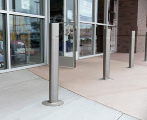 Stainless steel retractable bollards allow variable access to a storefront