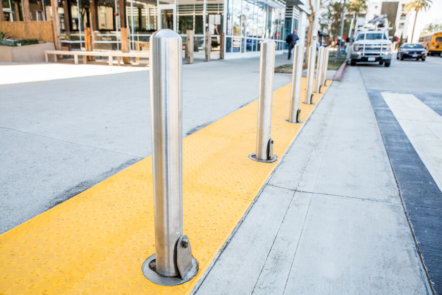 Stainless steel removable bollards separating sidewalk from street