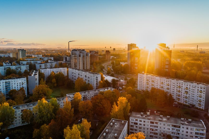 Aerial shot of a green city during golden hour