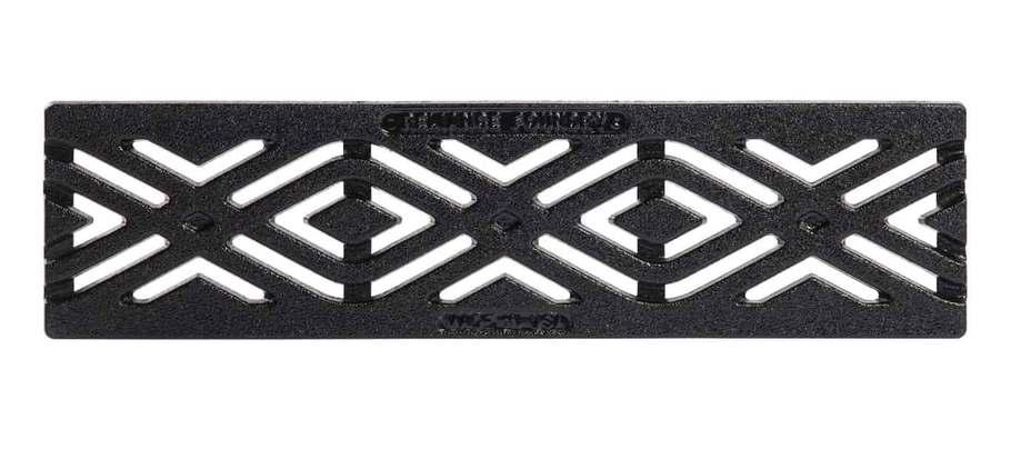 Studio shot of black decorative trench drain with an angular geometric slot pattern