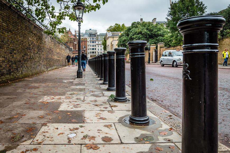 A row of bollards along the street
