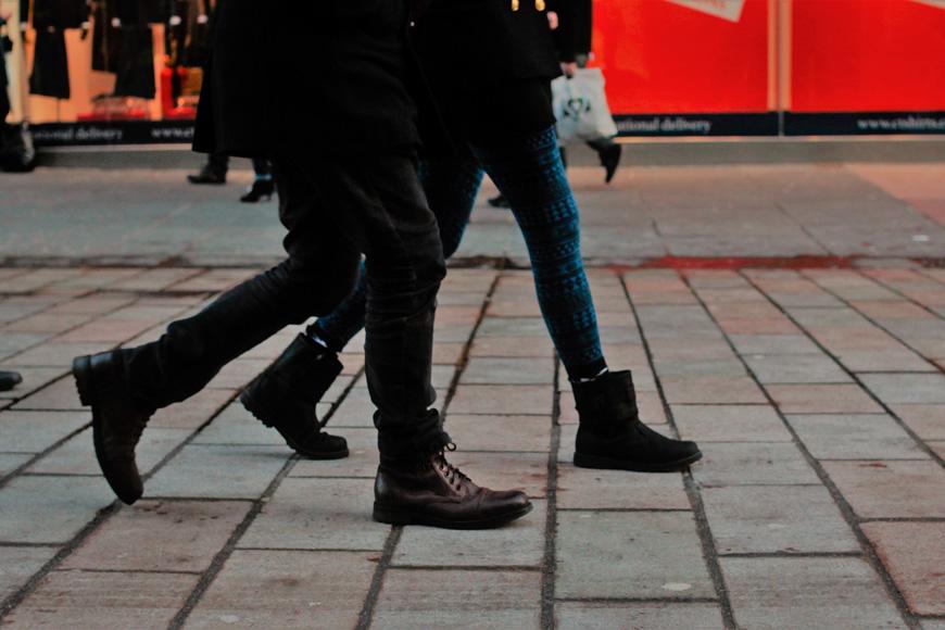 People's feet walking on pavement