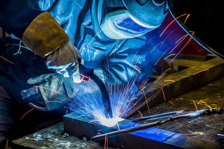 A welder is at work in a welding facility