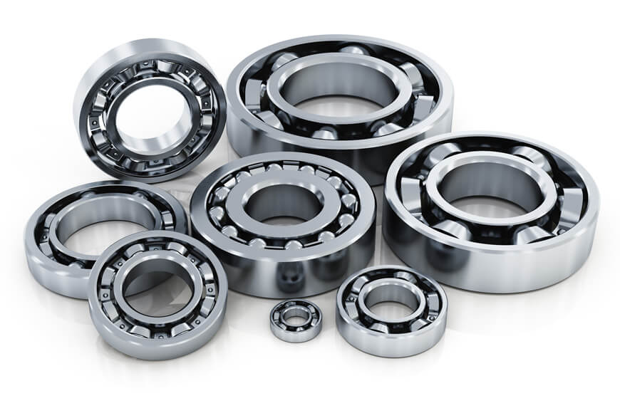 A few different wheel bearings are shown in a pile