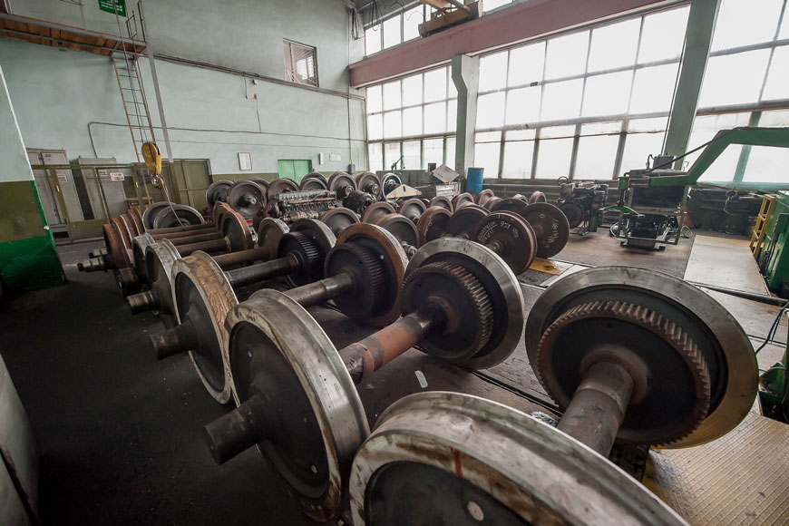 Stacks of steel flanged wheels in wheel manufacturing facility